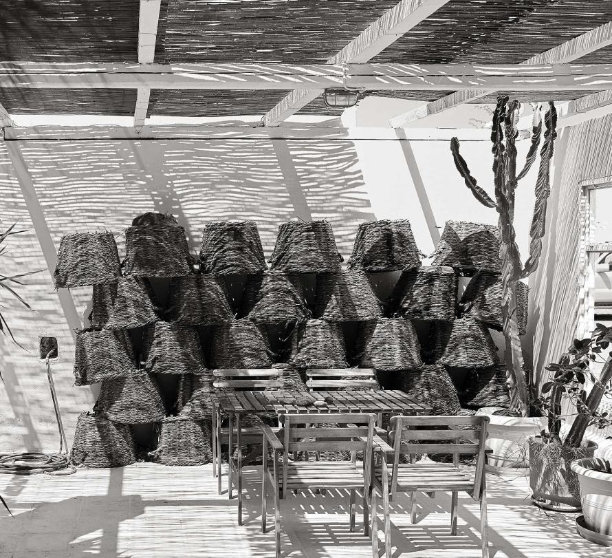 Gaia winery with baskets for harvesting stored on wall