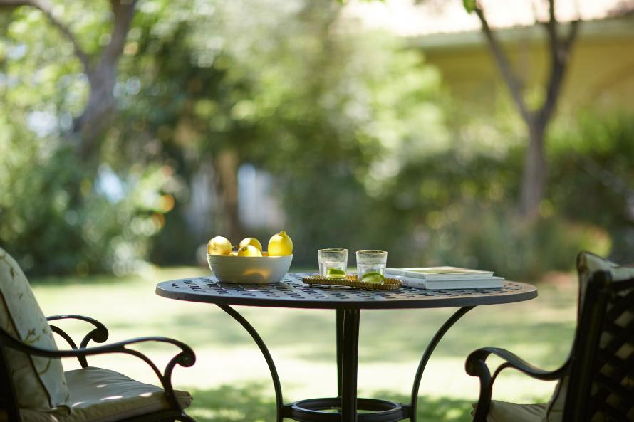 garden table with lemons and drink at Parga Beach