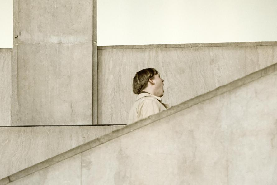 Man with open mouth at stairs, Palais de Tokyo, Paris